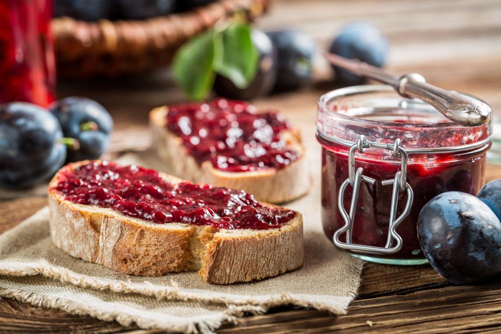 Closeup of sandwich with fresh plum jam